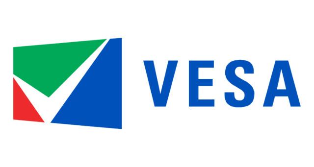 Das Logo der VESA. Sie normiert die Befestigungsöffnungen einer VESA-Halterung