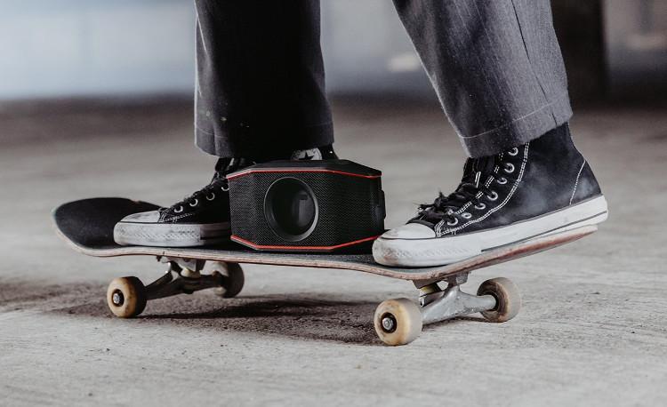 The Bluetooth speaker ROCKSTER GO on a skateboard.